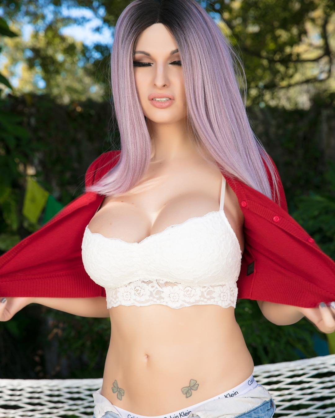 Beautiful Bailey Jay showing her boobies outside
