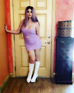 Bailey Jay in dress and boots