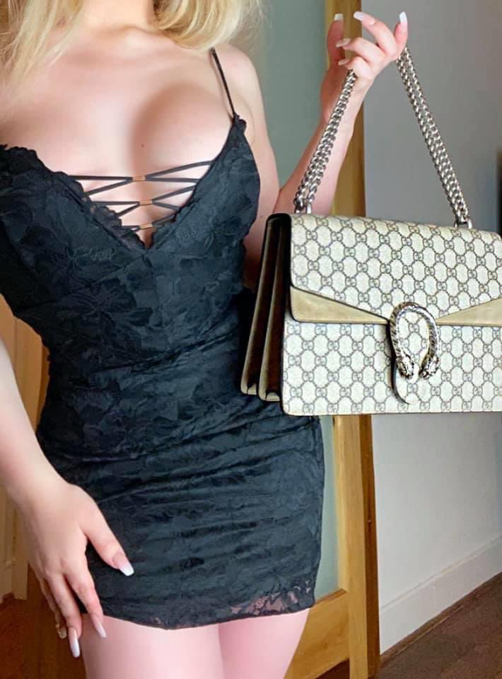 TS Haley Hilton shows her dress and purse